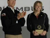 English: US weightlifter champion Karyn Marshall is inducted into the USA Weightlifting Hall of Fame as the Class of 2011; she receives an award from Arnold Schwarzenegger in Columbus, Ohio in March 2011.