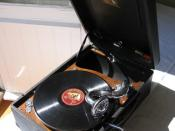 An early 1930s portable wind-up phonograph from His Master's Voice.