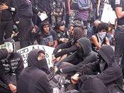 English: Anarchist punk in the 2005 Los Angeles anti police brutality protest right before facing off with the police.