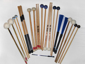 A photograph showing various types of beaters, such as; Mallets, Drum Sticks, & Brushes all used in the playing of percussion instruments.