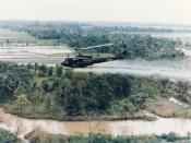 English: U.S. Huey helicopter spraying Agent Orange over Vietnam