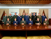 Formal and informal group photographs of the Joint Chiefs of Staff: GEN Colin Powell (USA), GEN Carl E. Vuono (USA), GEN Larry D. Welch (USAF), GEN Robert T. Herres (USAF), Admiral Carlisle A. H. Trost (USN), GEN Alfred M. Gray (USMC). Also other staff me