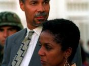 English: Mr. Randall Robinson and his wife wait for the helicopter that will take them to the airport. They were here to attend the inauguration ceremony of President Jean-Bertrand Aristide who was returned as President of Haiti during Operation Uphold De