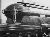 Raymond Loewy standing on one of his designs, the Pennsylvania Railroad's S1 steam locomotive.