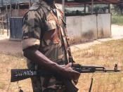 English: Nigerian Army soldier, part of the Economic Community Military Observation Group (ECOMOG), mans one of the six security checkpoints on the 36 mile road leading from Robert's International Airport to Monrovia, Liberia. The Nigerians were replaced