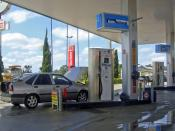 English: Natural gas pumps at a multifuel service station in the state of Parana, Brazil.