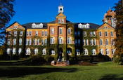 Saint Anselm College's Alumni Hall, built in 1889, it is the current administration building. This image was taken in April of 2009 on the Quad just a few hours after sunrise