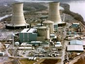 Color photograph of the Three Mile Island nuclear generating station, which suffered a partial meltdown in 1979. The reactors are in the smaller domes with rounded tops (the large smokestacks are just cooling towers).