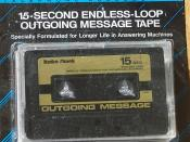 English: An endless loop outgoing message tape, as used by cassette-based answering machines of the late 1980s/early 1990s vintage.