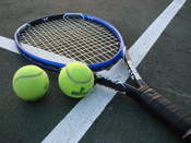 Shot of a tennis racket and two tennis balls on a court. Taken by myself of my racket. Intended for use in WikiProject Tennis Template. vlad § inger tlk 04:59, 18 June 2007 (UTC)