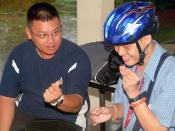 US Navy 070719-N-0120A-034 A Singapore navy sailor interacts with an intellectually disabled adult at a Movement for the Intellectually Disabled of Singapore (MINDS) training and development center