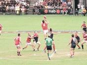 English: Aussie Rules Game on the Gold Coast, Queensland Featured teams: Adelaide Crows (Red) Melbourne Demons (Navy & Rouge)