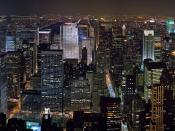 A 20 segment panoramic image of the New York Midtown skyline as viewed from the Empire State Building at night (looking North). Taken with a Canon 5D and 85mm f/1.8 lens at f/1.8, ISO 800 and 1/40s exposures.