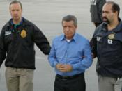 Miguel Rodriguez-Orejuela being escorted by DEA and US Customs agents.