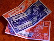 English: Canadian Tire Money which can be used as scrip in Canadian Tire stores under loyalty program, but is not considered a private currency