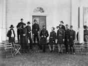Major General George Meade and staff posed in front of a building.