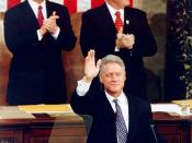English: Al Gore and Newt Gingrich applaud to US president Clinton waves during the State of the Union address in 1997.