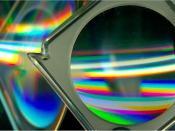 English: Image produced by arranging CD-ROMs and a magnifying glass on a flatbed scanner. Shows results of refraction, reflection, and diffraction.
