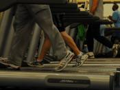 English: KUNSAN AIR BASE, South Korea— Airmen from the 8th Fighter Wing use cardio equipment at the fitness center. Cardiovascular exercise is one way to stay fit and maintain weight according to health and physical fitness experts.