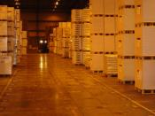 A logistics provider's warehouse of goods being stacked on pallets with a forklift.