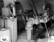 Detail interior view of Elysian Water Tower, Pumphouse, Frank Street Northeast, Elysian, Le Sueur County, Minnesota, showing fluoride monitor and main piping from Well No. 1. Original is 4 × 5 in. photograph.