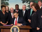 President Obama signs the Ryan White HIV/AIDS Treatment Extension Act of 2009.