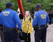 English: A woman protesting weak protections for whistleblowers at the Occupy Wall Street protest in New York.