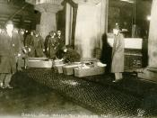 Photograph shows police or fire officials placing Triangle Shirtwaist Company fire victims in coffins.