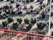 English: Another common form of calisthenics used in the Ncc for Physical Training or for punishment is the Crunches. To add difficulty to the exercise, cadets are usually attired in their long slacks and heavy boots and required to maintain that position