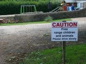 English: Free range Children I love this sign but I saw no children running wild as we walked up the road, let alone animals.