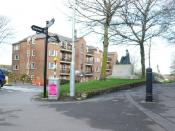 English: Hardy Locations, The Statue, Dorchester Hardy's statue stands at the top of The Grove close to the Top-of-the-Town roundabout. He looks over to the block of flats opposite named Henchard Court after the eponymous wife seller in his book