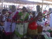 Tamil folk artists presenting a Villuppattu near Tirunelveli during a festival (panguni uththiram) at an Ayyanar temple.