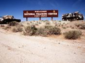 The National Training Center is a combat training center established to provide tough, realistic combined arms and services training for leaders, soldiers and units. Location: FORT IRWIN, CALIFORNIA (CA) UNITED STATES OF AMERICA (USA)