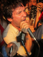 Tim Kasher performing in the crowd with Cursive at the Concert for Equality