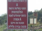 English: Signpost warning Israelis of forbidden entry to Area A near Hermesh. Literal translation: This way leads to Area 'A' located in control of the Palestinian Authority. Entrance of Israeli citizens into Area 'A' is forbidden, life-endangering, and a