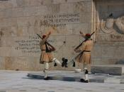 English: Evzones at the Tomb of the Unknown Soldier, Hellenic Parliament, Athens, Greece. The sculpture is of a Greek soldier and the inscriptions are excerpts from the Funeral Oration of Pericles, 430 B.C. in honour of Athenians slain in the Peloponnesia