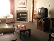 English: Master Suite with King bed, living room, dining area and full kitchen.