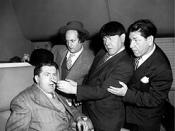 Curly Howard returns to the act, albeit briefly, in Hold That Lion!. This marked the only instance in which brothers Curly, Moe and Shemp appeared together on screen.