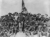 English: Col Theodore Roosevelt stands triumphant on San Juan Hill, Cuba after his