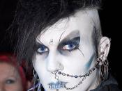 "A German Goth, a so called ""Gruftie"", with rosary beads and alchemical symbol on forehead."