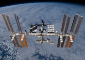 English: The International Space Station as seen in its ULF3 configuration by the departing Space Shuttle Atlantis, following the departure of STS-129, which delivered ExPRESS Logistics Carriers 1 & 2 to the orbital outpost. The newly-arrived Russian Pois