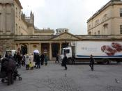 English: A lot going on outside the Baths A delivery van, pigeons, people passing by, and the Digital TV revolution comes to Bath