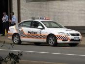 ACT Police vehicle (Ford Falcon FG) and uniformed officers in Canberra, Australian Capital Territory