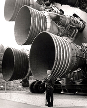 Dr. von Braun stands by the five F-1 engines