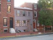 The Walt Whitman House in Camden, NJ, where Walt Whitman spent the last years of his life. Note: Whitman's House is the gray one in the middle, not made of brick. The house to the right serves as the Visitors Center.