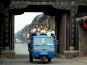 Chinese rural citizens are going downtown to Pingyao for work earlier morning in June 2007