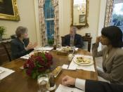English: President George W. Bush is joined for lunch Wednesday, October 5, 2005, by Secretary of State Dr. Condoleezza Rice and Karen Hughes, then newly appointed Under Secretary of State for Public Diplomacy and Public Affairs.