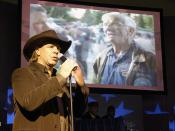 Michael Peterson sings at recent Army Community Covenant signing