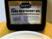 A can of neatsfoot oil and a small dollop of the product poured out on a paper plate. I can't believe I just took a photo of neatsfoot oil for wiki
