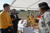 English: Maj. Krista Bryant, Army public health nurse from the Mannheim Public Health Clinic, discusses how to prevent sexually transmitted diseases at the Coleman Barracks Health and Dental Clinic health fair in Manheim, Germany, Sept. 25.